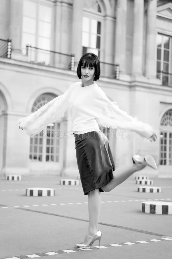 Woman bend leg on square in paris, france royalty free stock images