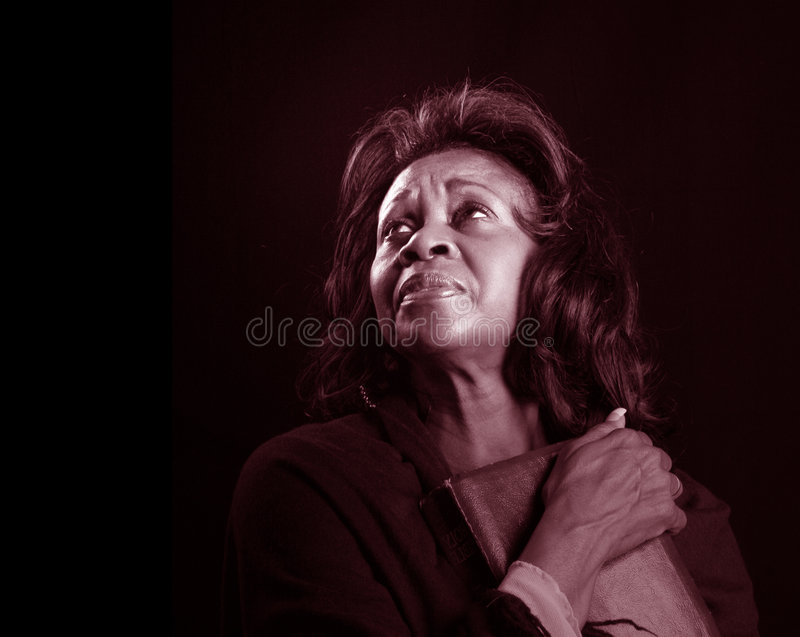 Woman with Bible BW stock image