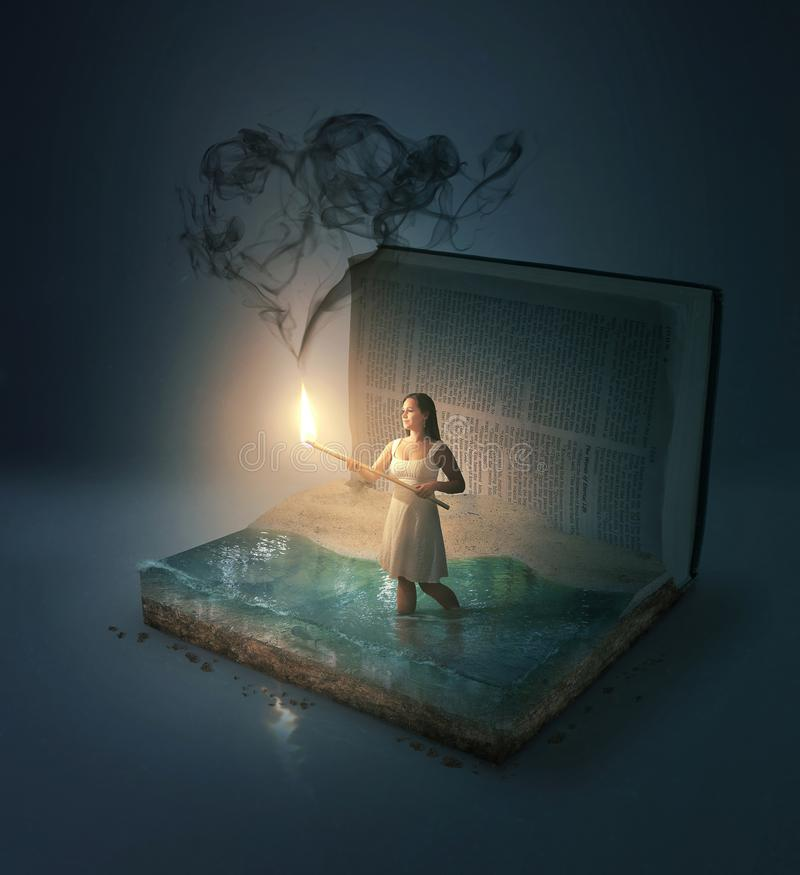 Matchstick and heart shape. A woman in a Bible with heart shaped smoke royalty free stock photos