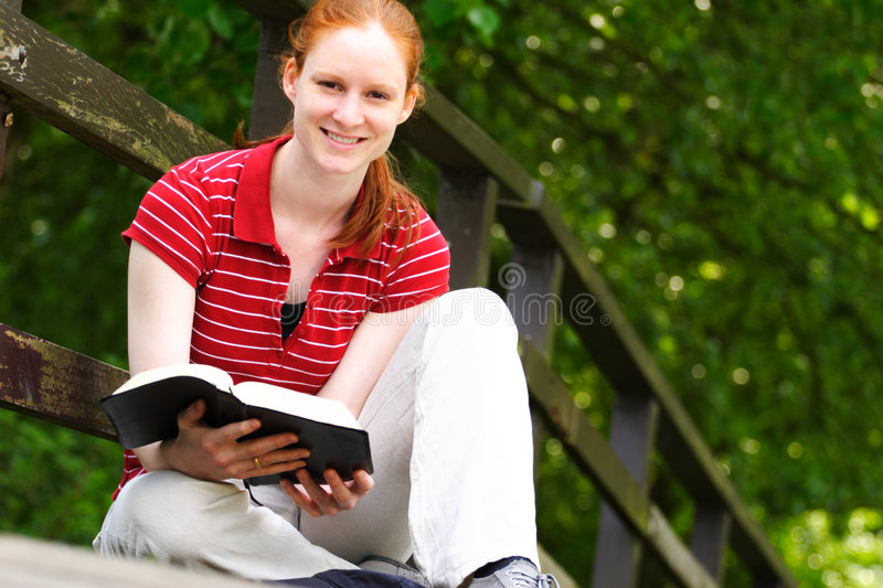 A Woman with a Bible in Her Hands royalty free stock image