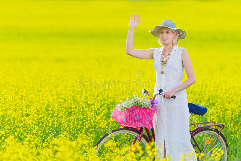 Download Woman and bicycle stock image. Image of countryside, summertime - 25510321