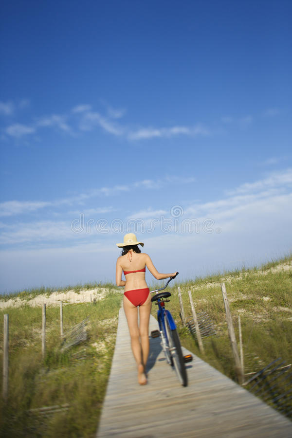 Download Woman With Bicycle On Boardwalk Stock Photos - Image: 12676073