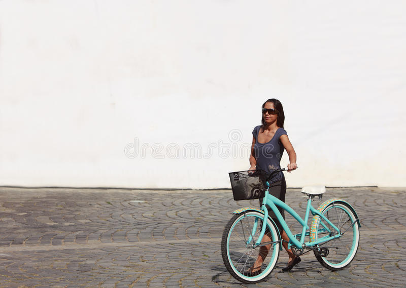 Woman With A Bicycle In A City Stock Photo