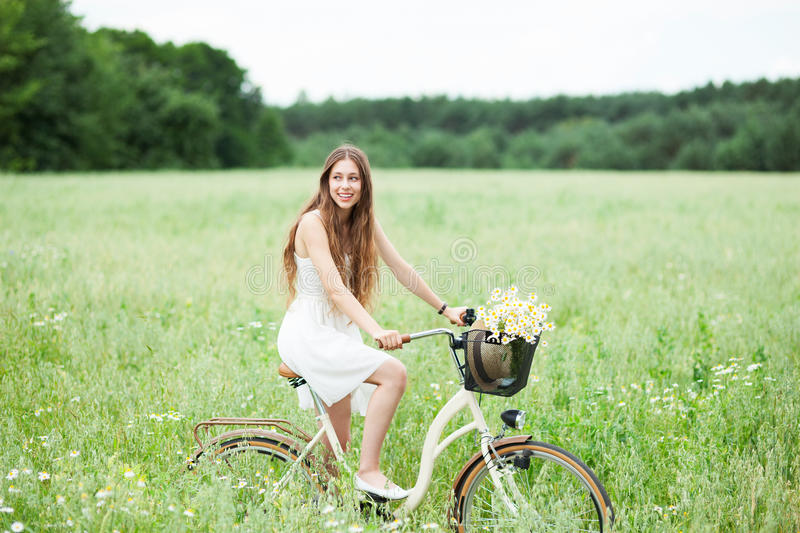 Download Woman on bicycle in field stock photo. Image of idyllic - 25747774
