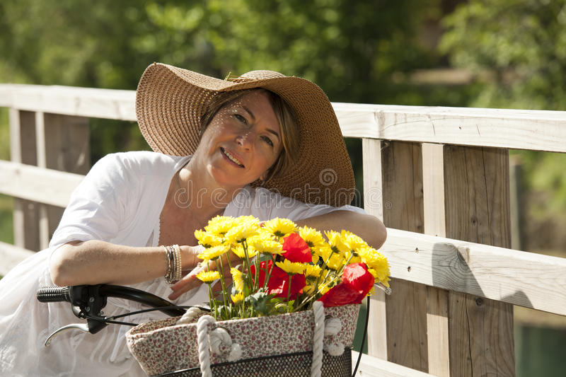 Download Woman With Bicycle And Flowers Stock Photo - Image: 25944218