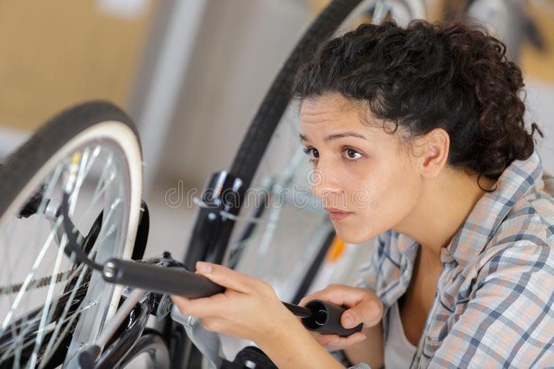 Woman with bicycle pump royalty free stock image