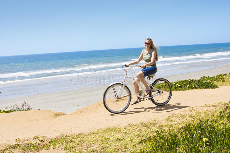 Woman on a Bicycle Ride along the beach stock photos