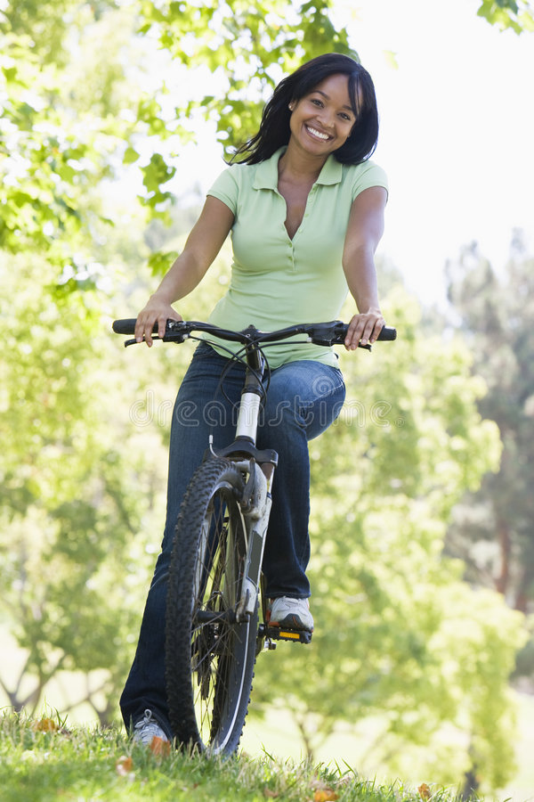 Woman on bicycle smiling royalty free stock photos