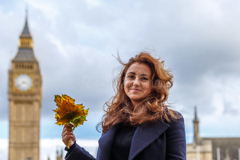 Woman and Big ben in the autumn. Westminster royalty free stock photo