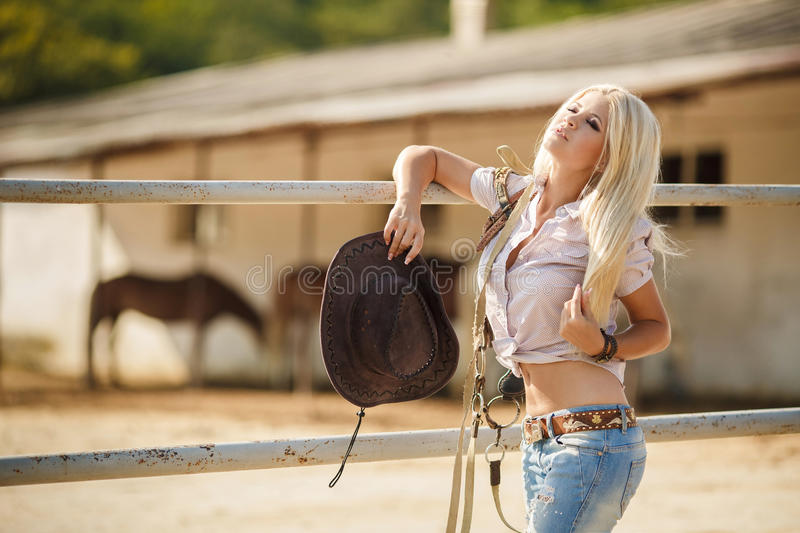 The woman in a big cowboy's hat on the ranch royalty free stock photos