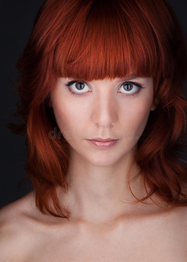 Woman with big eyes and red hair stock image