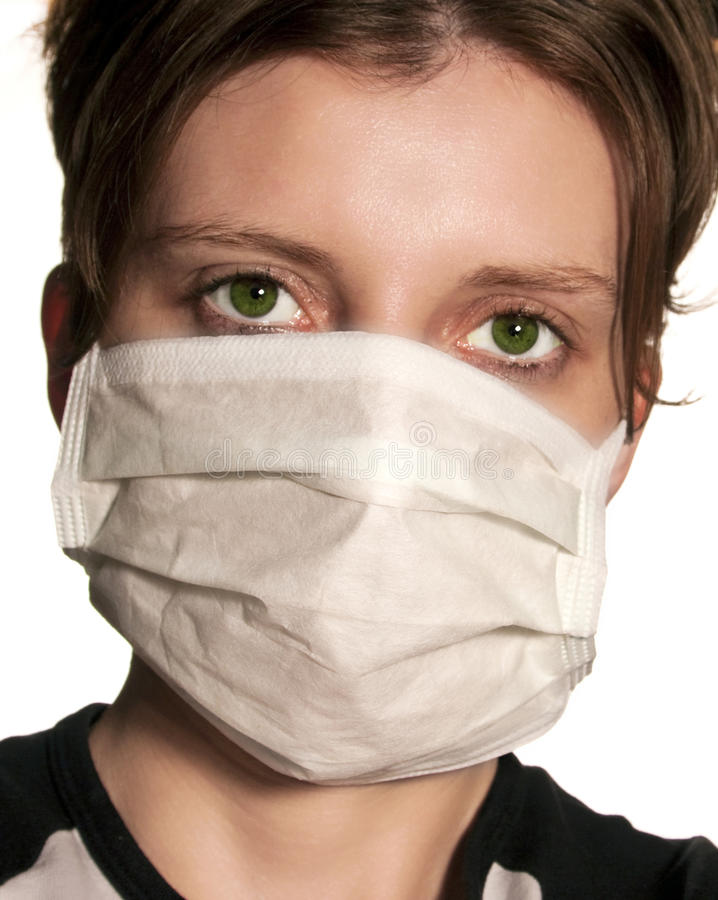 Woman with big green eyes wearing medical mask. Protecting against flu virus stock photos