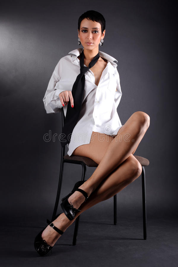Woman in big man shirt and tie stock images