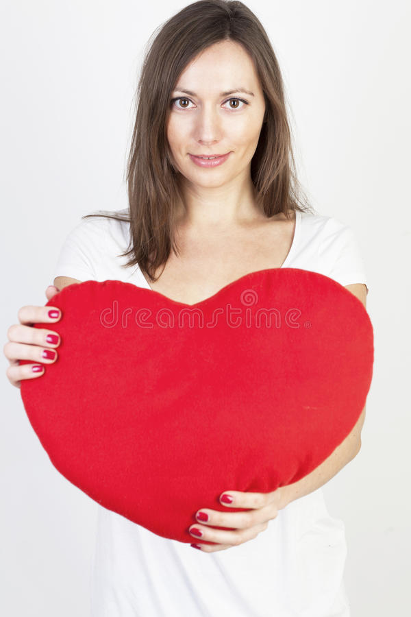 Woman with a big red heart stock images