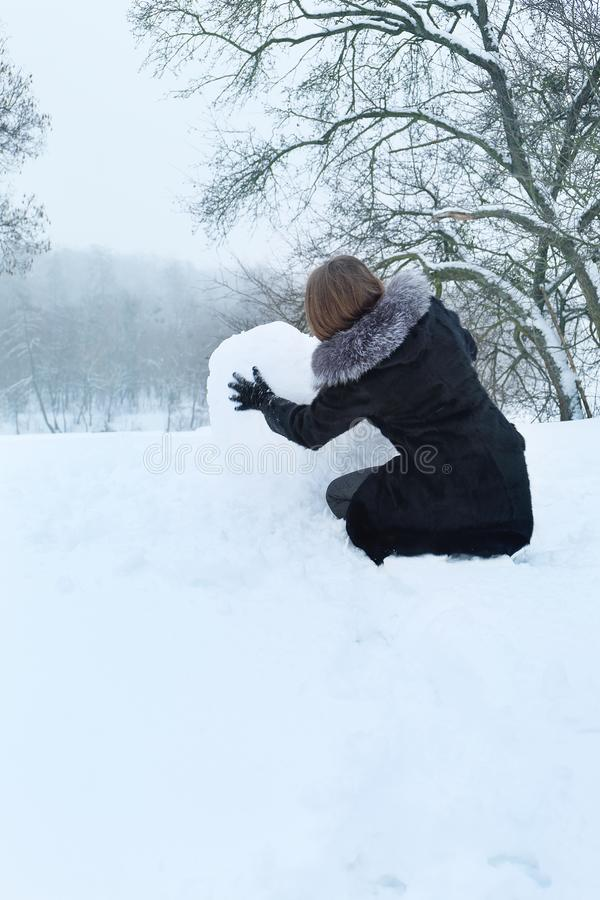 A woman with big snow ball stock photo