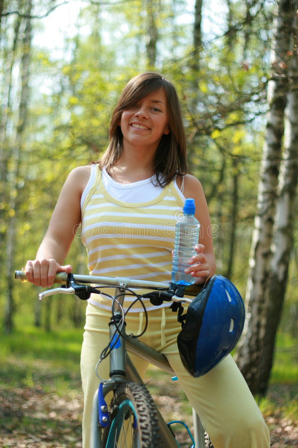 Woman and bike royalty free stock photography
