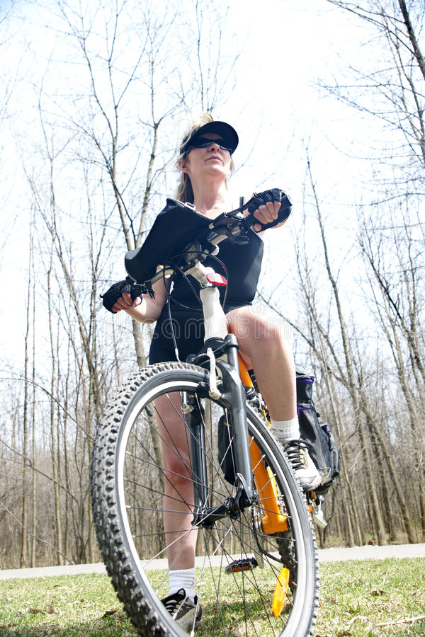 Woman and bike royalty free stock image