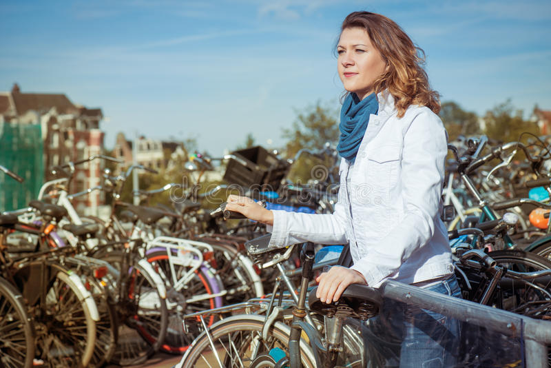 Woman at a bike parking in Amsterdam stock photography