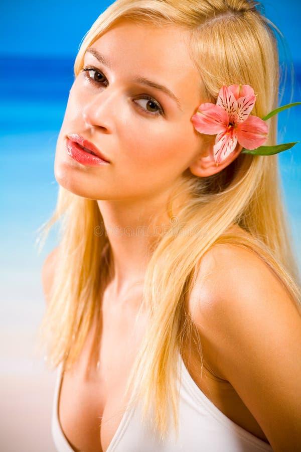 Woman in bikini on beach stock photos