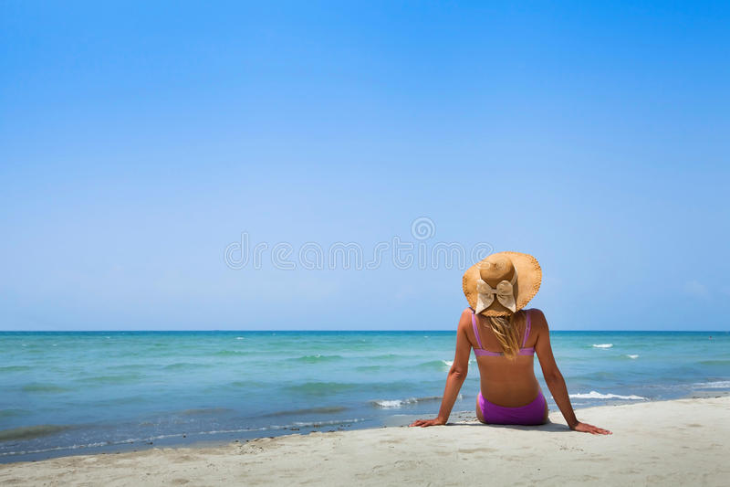 Woman in bikini on the beach stock images