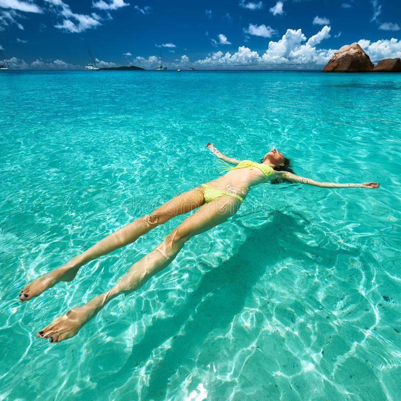Download Woman In Bikini Lying On Water Stock Image - Image: 41878661