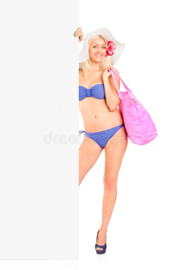 Download Woman In Bikini Standing And Holding A Panel Stock Image - Image: 26300943