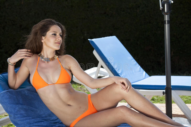 Woman in bikini on sun chair stock photography