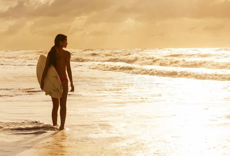 Woman Bikini Surfer & Surfboard Sunset Beach royalty free stock images