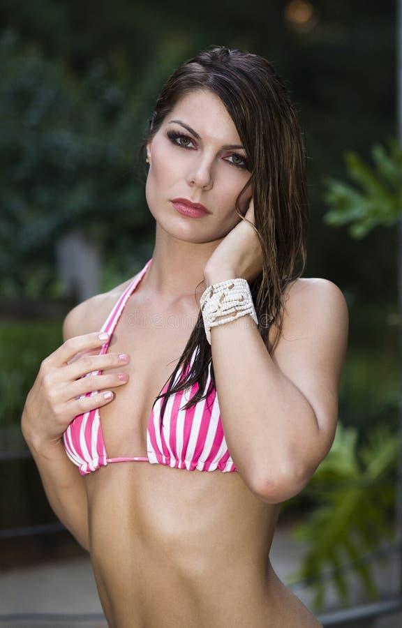 Woman in bikini top stock photography