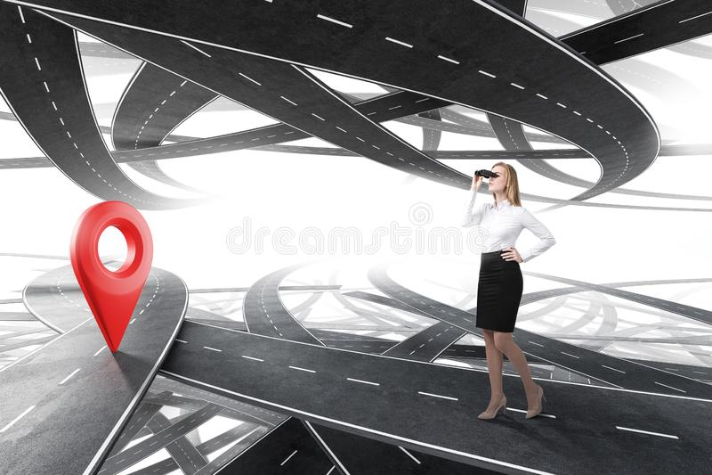 Woman with binoculars looking for her goal royalty free stock photo