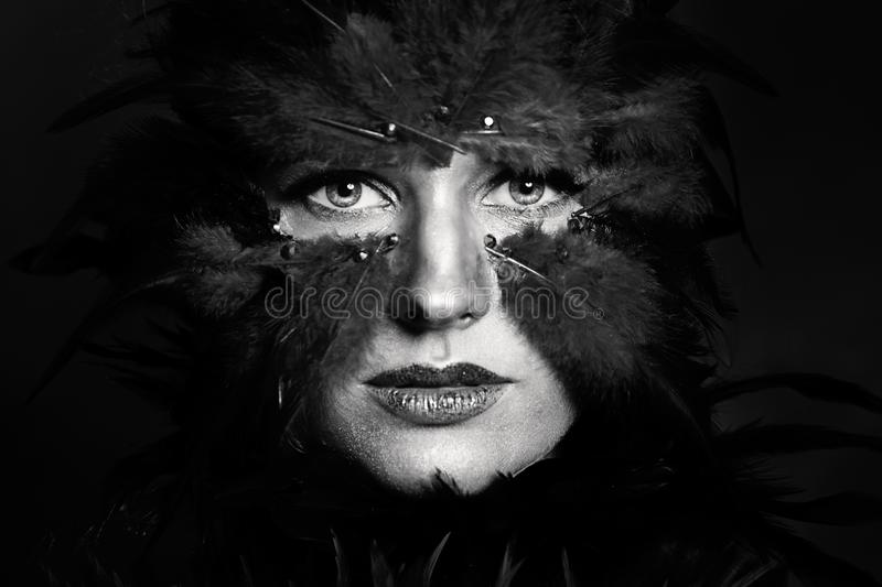 Woman bird with Halloween party makeup, black and white portrait royalty free stock images