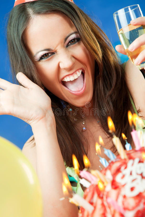 Woman birthday cake. Happy female smiling behind birthday cake with burning candles stock photography