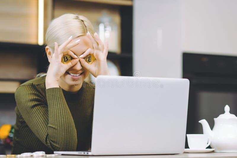 Woman bitcoin laptop stock photos