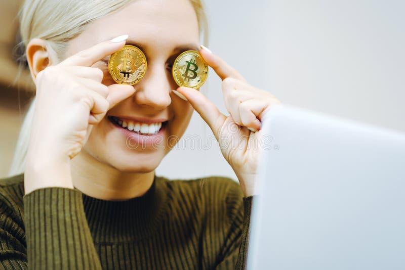Woman bitcoin laptop royalty free stock image