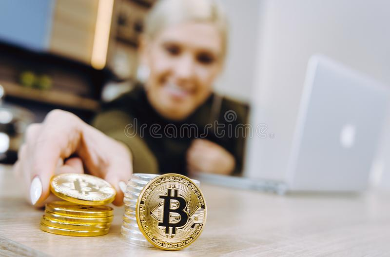 Woman bitcoin trading stock photos