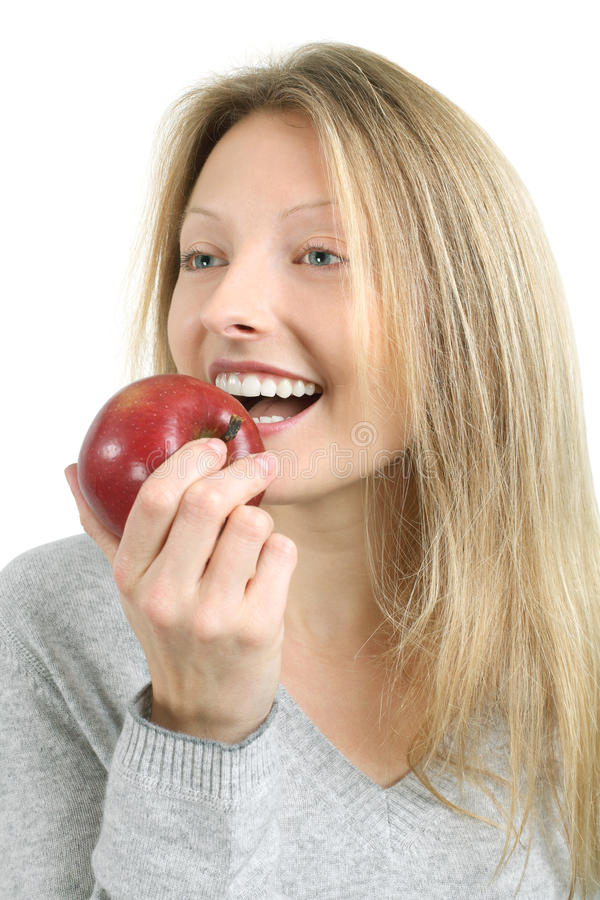 Woman Biting Into An Apple Stock Photo