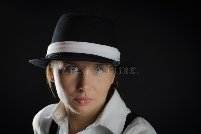 Woman in black background royalty free stock photography