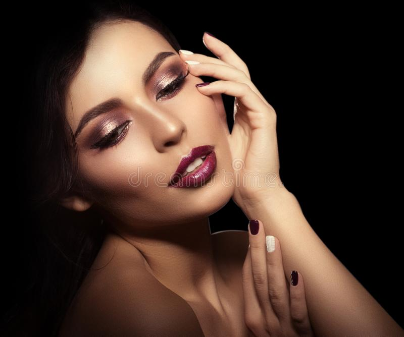 Woman on a black background. Beautiful bright fashion model. Beauty girl. Luxurious lady with a stylish make-up and manicure. stock photography