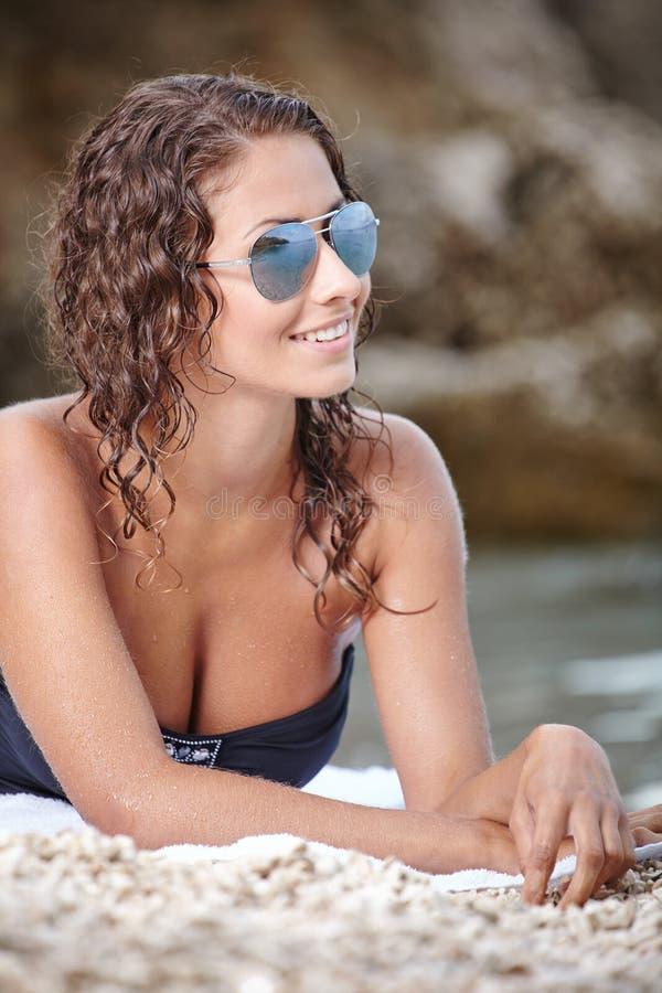 Woman In Black Bikini On Beach Stock Image