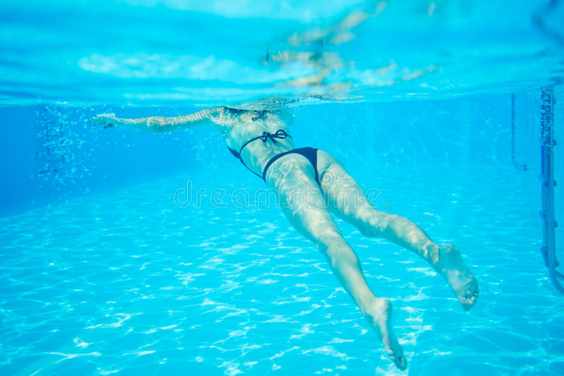 Woman In Black Bikini Floating At Swimming Pool Photo Underwater Stock Image Image 88269345