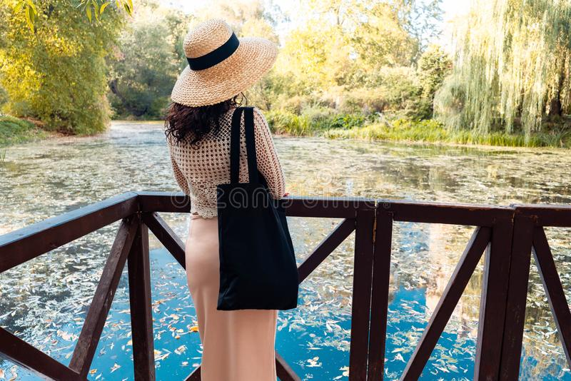 Woman with black blank bag outdoors in park. Place for Empty space. Copy space. Eco friendly. stock image