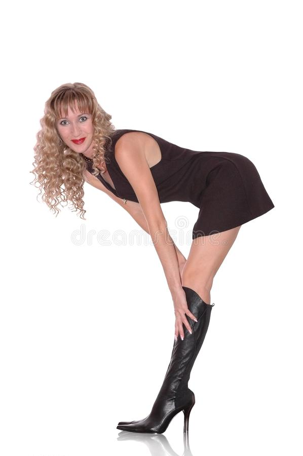 The woman in black boots royalty free stock photography