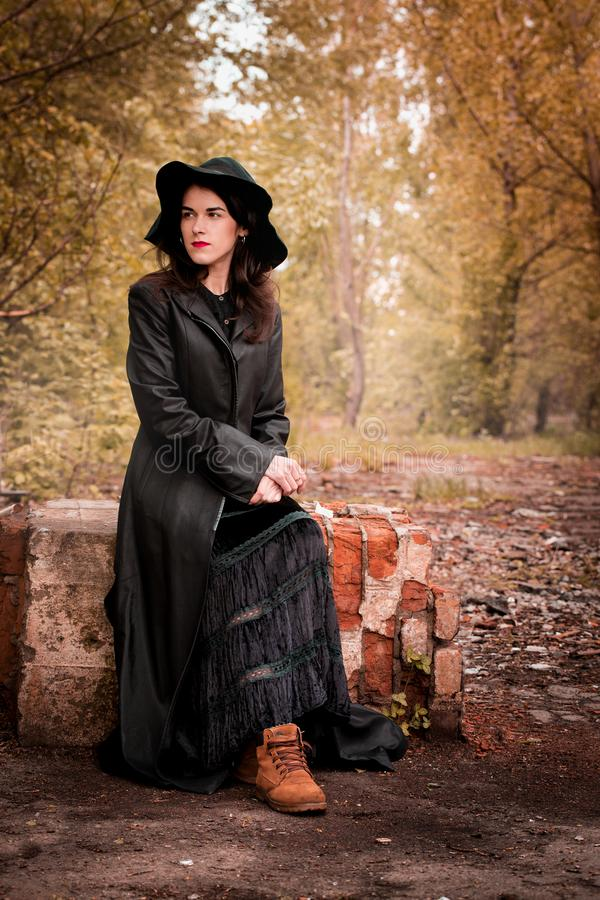 Woman sits on the old ruins royalty free stock images