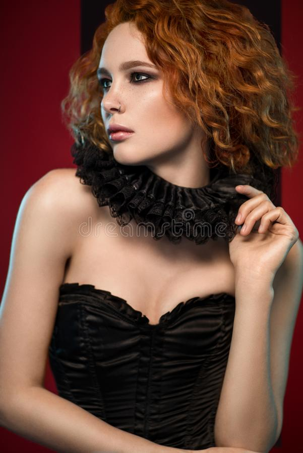 Woman in black corset and frill stock photo