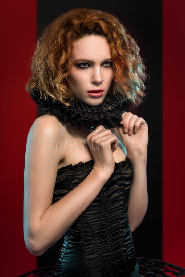 Woman in black corset and frill stock photos