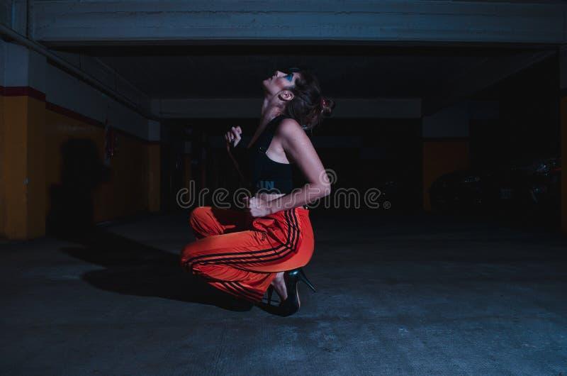 Woman in Black Crop Top Sitting on Concrete Floor stock photos