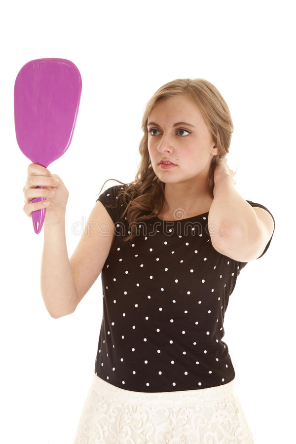 Woman black dots mirror look stock photo