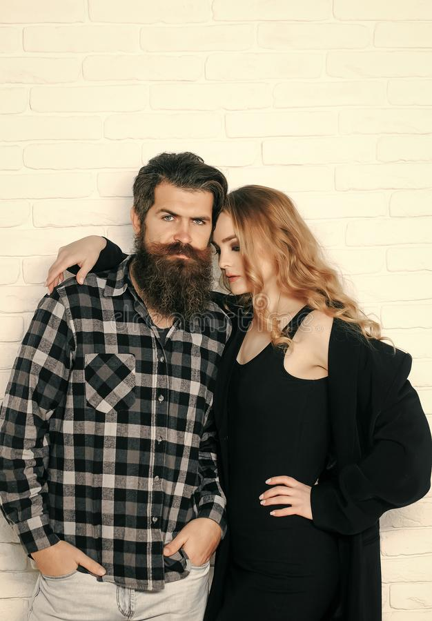 Woman in black dress, coat hug man in plaid shirt royalty free stock photography