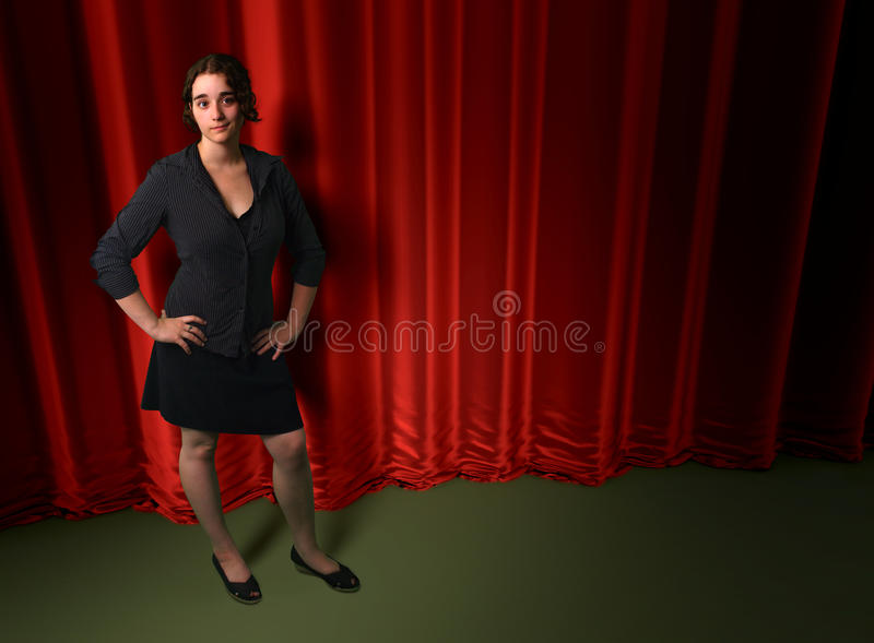 Woman black dress concert red curtain backdrop scene stock photo