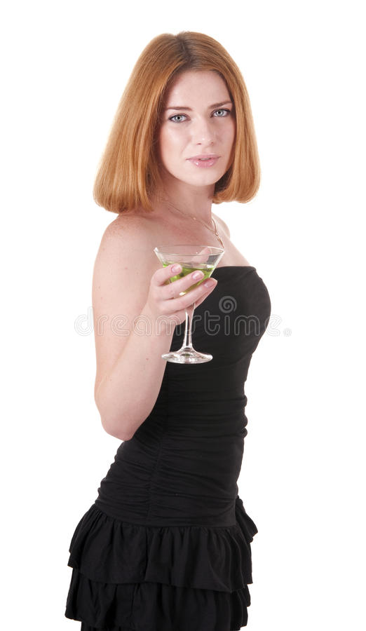 Woman in black dress with a drink. Isolated on white background royalty free stock image